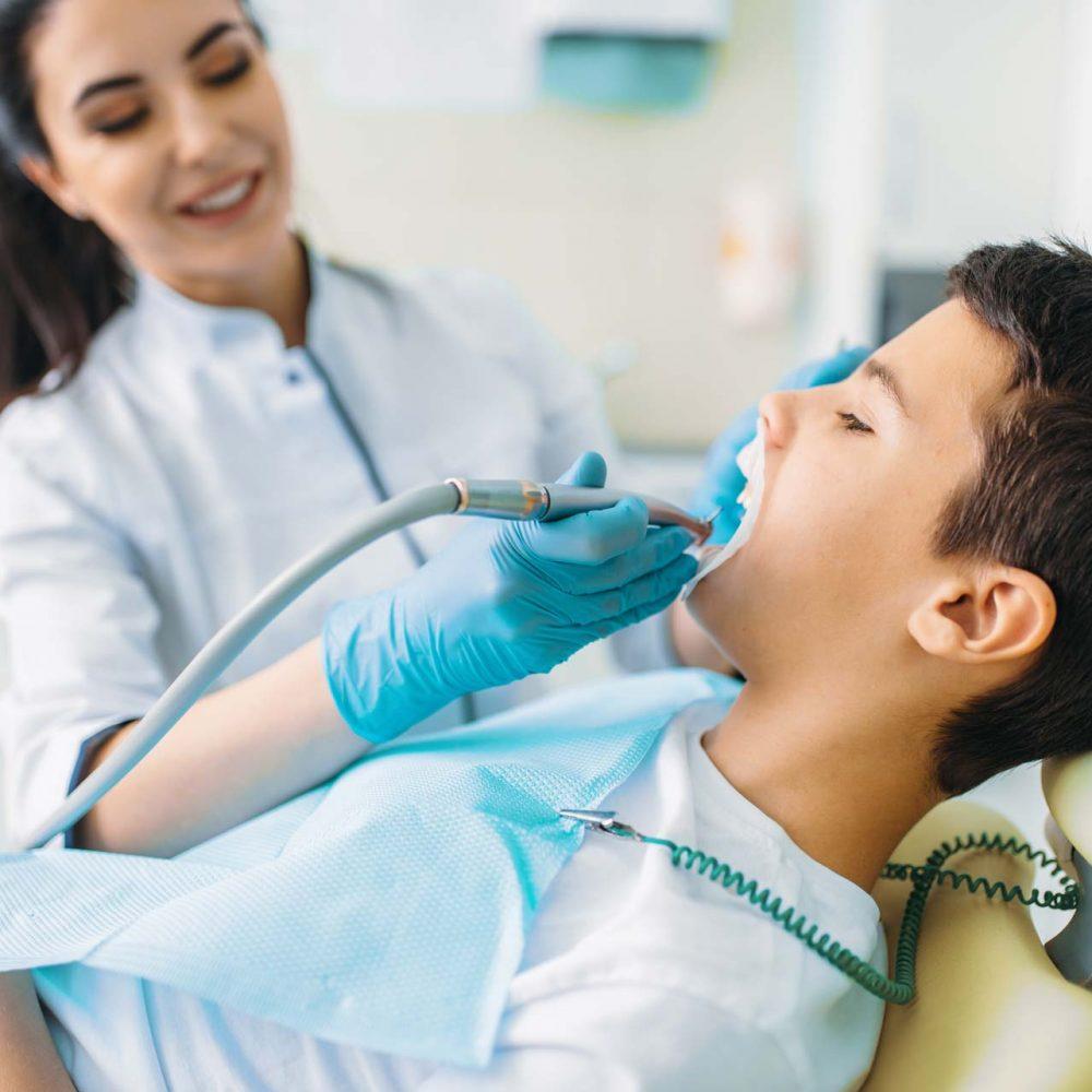 caries-removal-procedure-children-stomatology-H2ZESXA.jpg